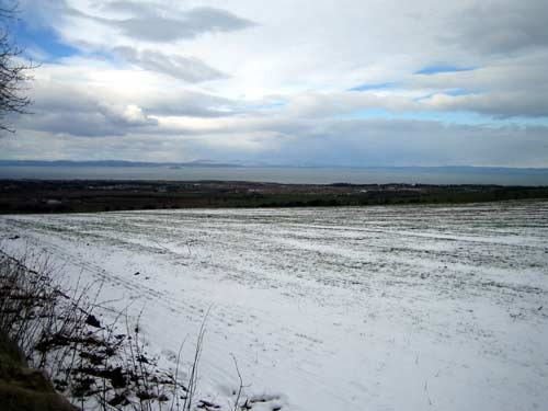 Left-hand view of Carberry Hill with the Firth of Forth in the distance