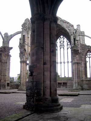 A view of the Presbytery and the High Altar behind the pillar