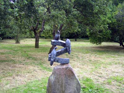 Bird sculpture in the orchard